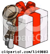 Gray Explorer Ranger Man Leaning On Gift With Red Bow Angle View