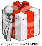 Gray Design Mascot Woman Leaning On Gift With Red Bow Angle View