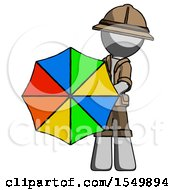 Gray Explorer Ranger Man Holding Rainbow Umbrella Out To Viewer