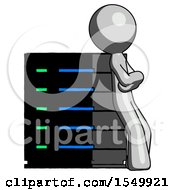 Gray Design Mascot Man Resting Against Server Rack Viewed At Angle