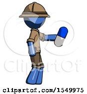 Blue Explorer Ranger Man Holding Blue Pill Walking To Right