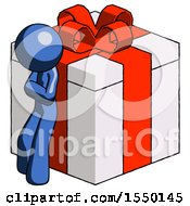 Blue Design Mascot Man Leaning On Gift With Red Bow Angle View