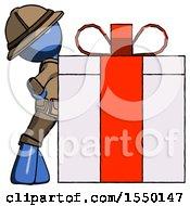 Blue Explorer Ranger Man Gift Concept Leaning Against Large Present