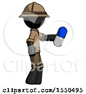 Black Explorer Ranger Man Holding Blue Pill Walking To Right