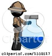 Black Explorer Ranger Man Standing Beside Large Round Flask Or Beaker