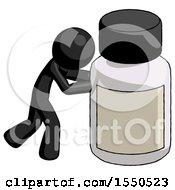 Black Design Mascot Man Pushing Large Medicine Bottle