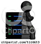 Black Design Mascot Man Resting Against Server Rack Viewed At Angle