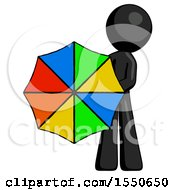 Black Design Mascot Man Holding Rainbow Umbrella Out To Viewer