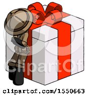 Black Explorer Ranger Man Leaning On Gift With Red Bow Angle View