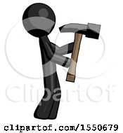 Black Design Mascot Man Hammering Something On The Right