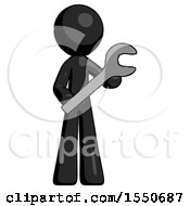Black Design Mascot Man Holding Large Wrench With Both Hands