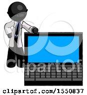 Black Doctor Scientist Man Beside Large Laptop Computer Leaning Against It