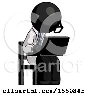 Black Doctor Scientist Man Using Laptop Computer While Sitting In Chair Angled Right