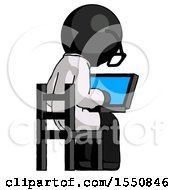 Black Doctor Scientist Man Using Laptop Computer While Sitting In Chair View From Back