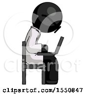 Black Doctor Scientist Man Using Laptop Computer While Sitting In Chair View From Side