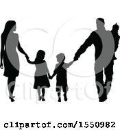Silhouetted Family Holding Hands And Walking
