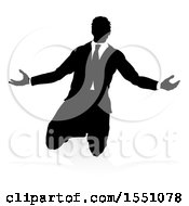 Silhouetted Business Man Kneeling And Worshiping With A Shadow On A White Background