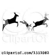 Clipart Of A Black Silhouetted Deer Family Leaping With A Shadow On A White Background Royalty Free Vector Illustration