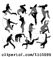 Silhouetted Male Dancers