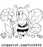 Poster, Art Print Of Black And White Bee Holding A Flower
