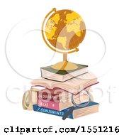 Golden Desk Globe On A Stack Of Books