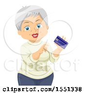 Happy Senior Woman Holding A Credit Card