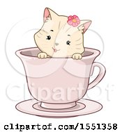Clipart Of A Female Kitty Cat In A Tea Cup Royalty Free Vector Illustration