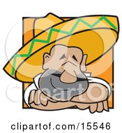 Friendly And Happy Mexican Man Wearing A Sombrero Resting His Head On His Arms While Smiling