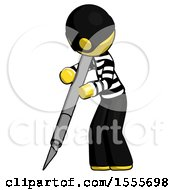 Yellow Thief Man Cutting With Large Scalpel