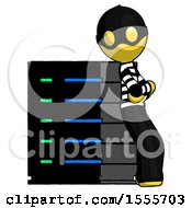 Yellow Thief Man Resting Against Server Rack Viewed At Angle