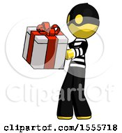 Yellow Thief Man Presenting A Present With Large Red Bow On It