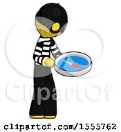 Yellow Thief Man Looking At Large Compass Facing Right