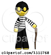 Yellow Thief Man Standing With Hiking Stick