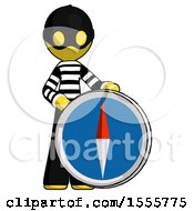 Yellow Thief Man Standing Beside Large Compass