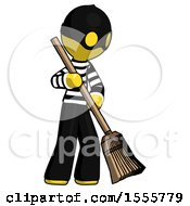 Yellow Thief Man Sweeping Area With Broom