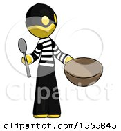 Yellow Thief Man With Empty Bowl And Spoon Ready To Make Something