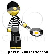 Poster, Art Print Of Yellow Thief Man Frying Egg In Pan Or Wok Facing Right