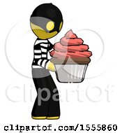 Yellow Thief Man Holding Large Cupcake Ready To Eat Or Serve
