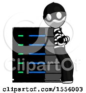 White Thief Man Resting Against Server Rack Viewed At Angle