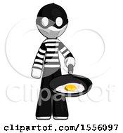 Poster, Art Print Of White Thief Man Frying Egg In Pan Or Wok