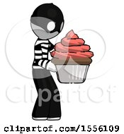 White Thief Man Holding Large Cupcake Ready To Eat Or Serve