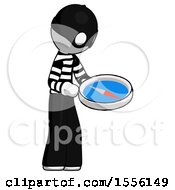 White Thief Man Looking At Large Compass Facing Right