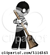 White Thief Man Sweeping Area With Broom