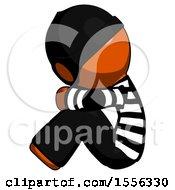 Orange Thief Man Sitting With Head Down Facing Sideways Left
