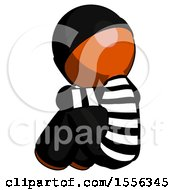 Orange Thief Man Sitting With Head Down Back View Facing Left