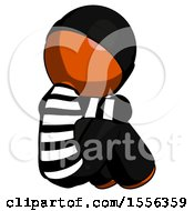 Orange Thief Man Sitting With Head Down Back View Facing Right