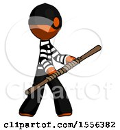 Orange Thief Man Holding Bo Staff In Sideways Defense Pose