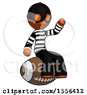 Orange Thief Man Sitting On Giant Football