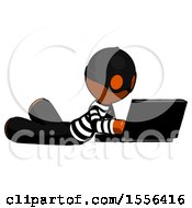Orange Thief Man Using Laptop Computer While Lying On Floor Side Angled View