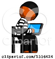 Orange Thief Man Using Laptop Computer While Sitting In Chair View From Back